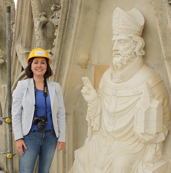 Jennifer Feltman standng by a statue