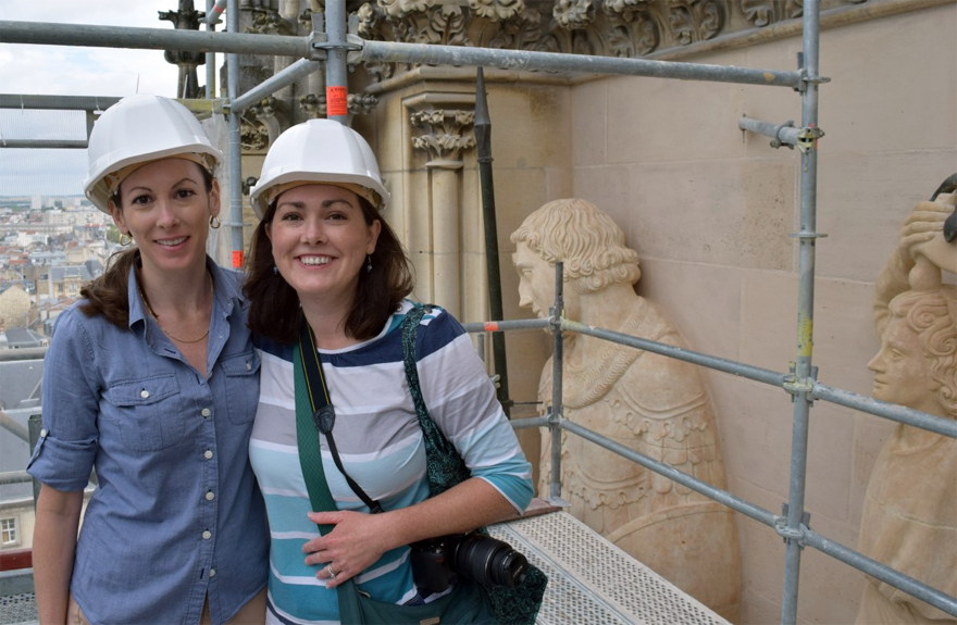 Karlyn Griffith and Jennifer Feltman on the facade of Reims Cathedral