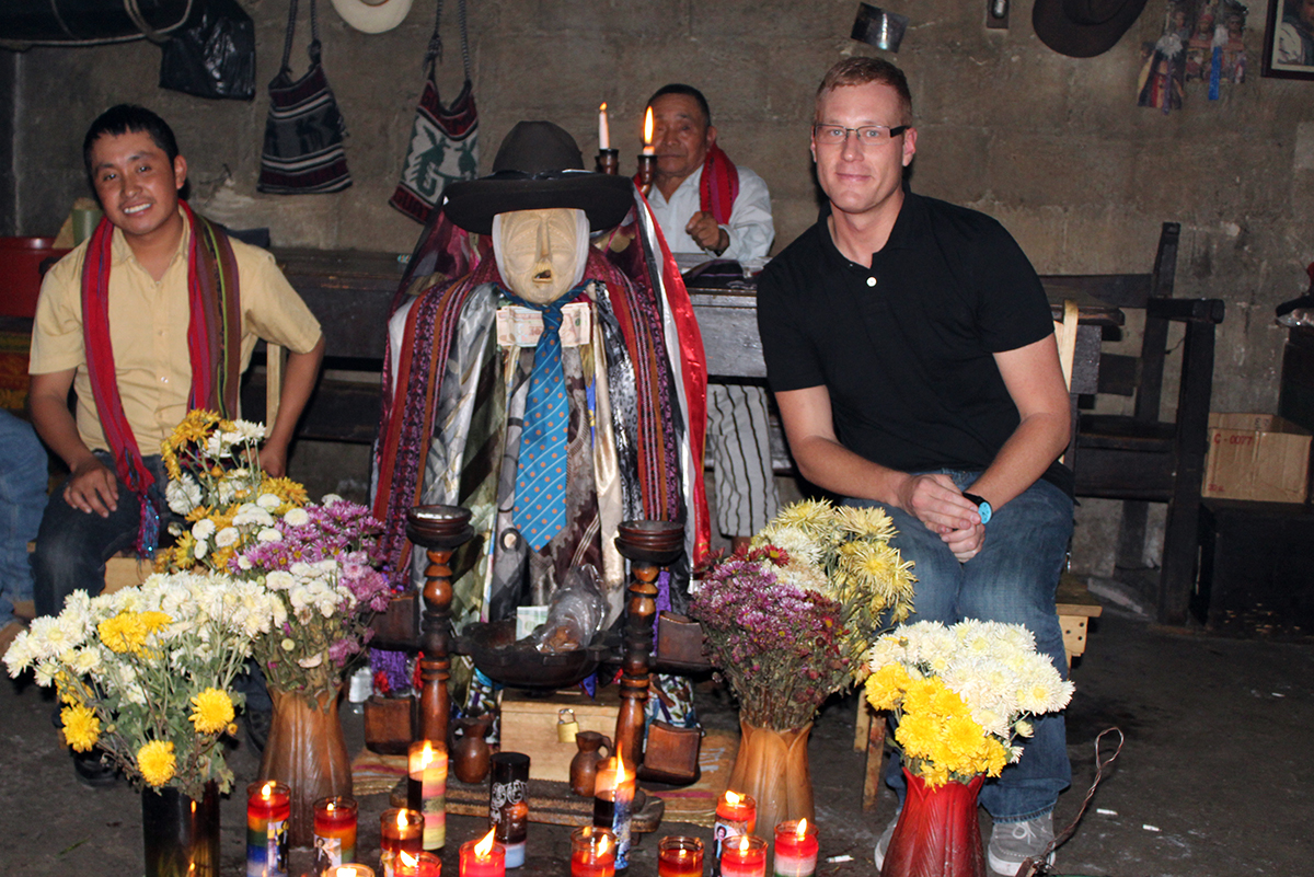 "Bryan Schaeffer with Maximon and one of Maximon's ""aj q'iij' - ritual specialists - in Guatemala, 2016"