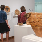 Students looking at interwoven exhibtion