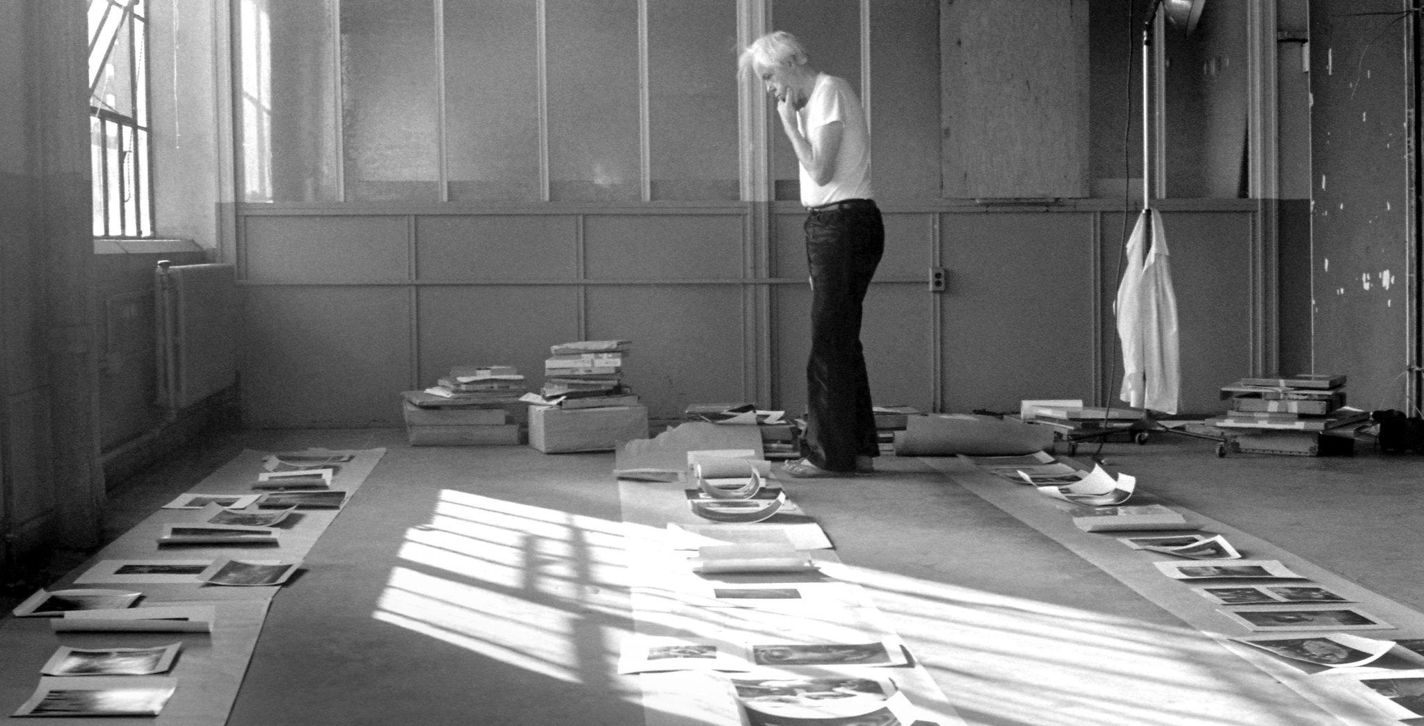 Minor White laying out an exhibition at MIT, 1974