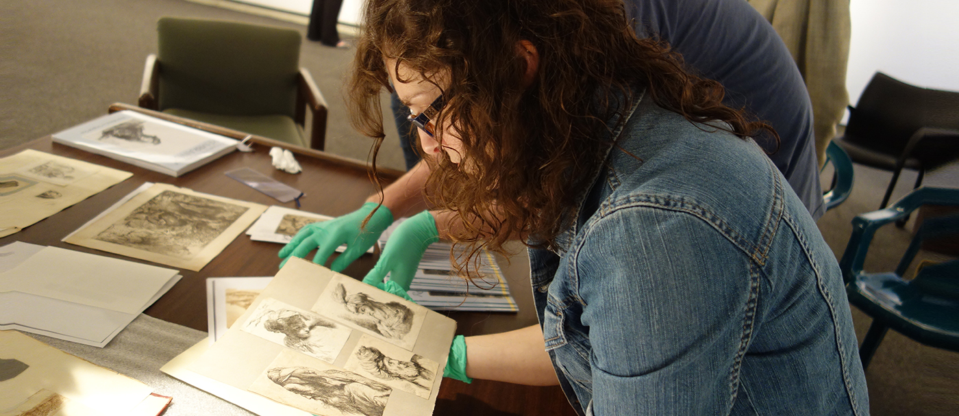 Doctoral student studying prints
